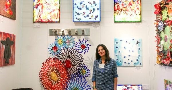 Hasna Sal surrounded by her artwork