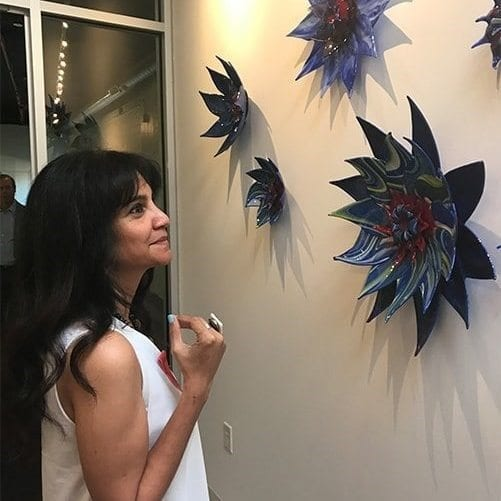 Passionately pursuing the creation of glass artwork including glass sinks, glass wall hangings, glass lamps, glass tableware & table tops, and glass jewelry, Hasna Sal studied fine art in England and Wales with an exhibition of watercolor renderings at the Cornwall Museum in 1997.